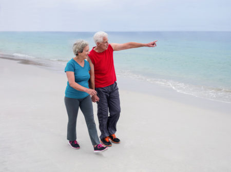 senior-walking-club-on-beach